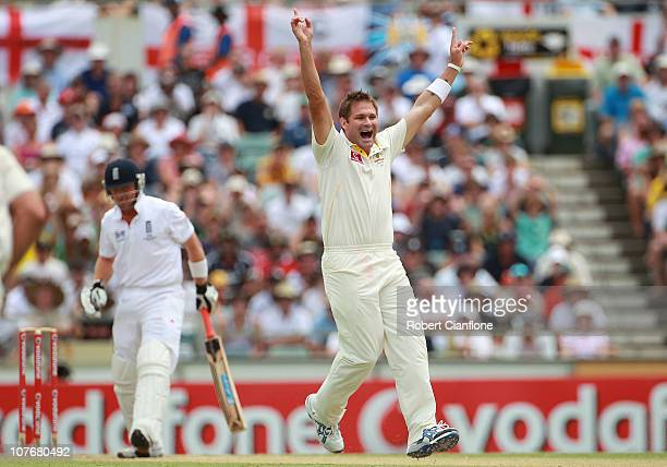 Ryan Harris of Australia takes the wicket of Ian Bell of England during day four of the Third Ashes Test match between Australia and England at WACA...