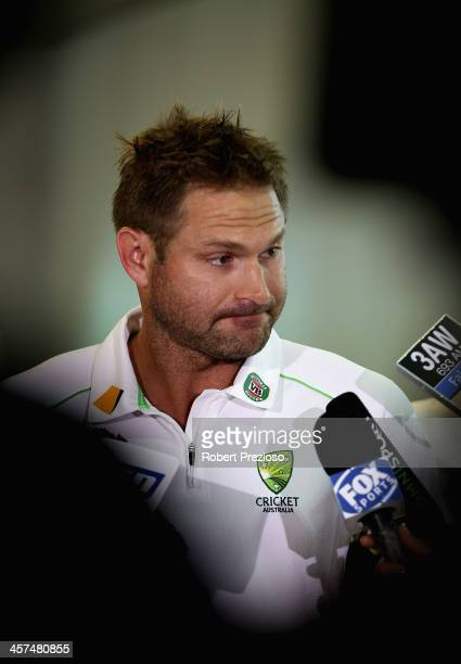 Ryan Harris speaks to the media on arrival along with Peter Siddle at Melbourne Airport on December 18 2013 in Melbourne Australia Siddle and Harris...