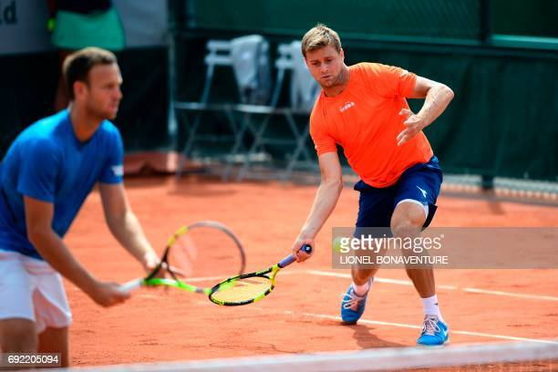 US Ryan Harrison and NewZealand's Michael Venus play against India's Purav Raja and India's Divij Sharan during their men doubles tennis match at the...