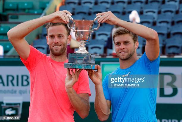 US Ryan Harrison and teammate New Zealand's Michael Venus pose with their trophy after winning the men's doubles tennis match against Mexico's...