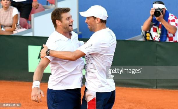 Ryan Harrison clebrates with teammate Mike Bryan after winning match against Croatia's Ivan Dodig and Mate Pavic in their doubles rubber during the...