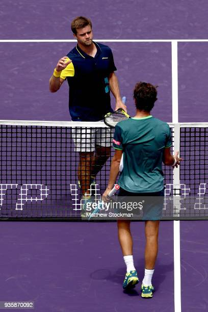 Ryan Harrison congratulates Joao Sousa of Portugal after their match during the Miami Open on March 21 2018 in Key Biscayne Florida