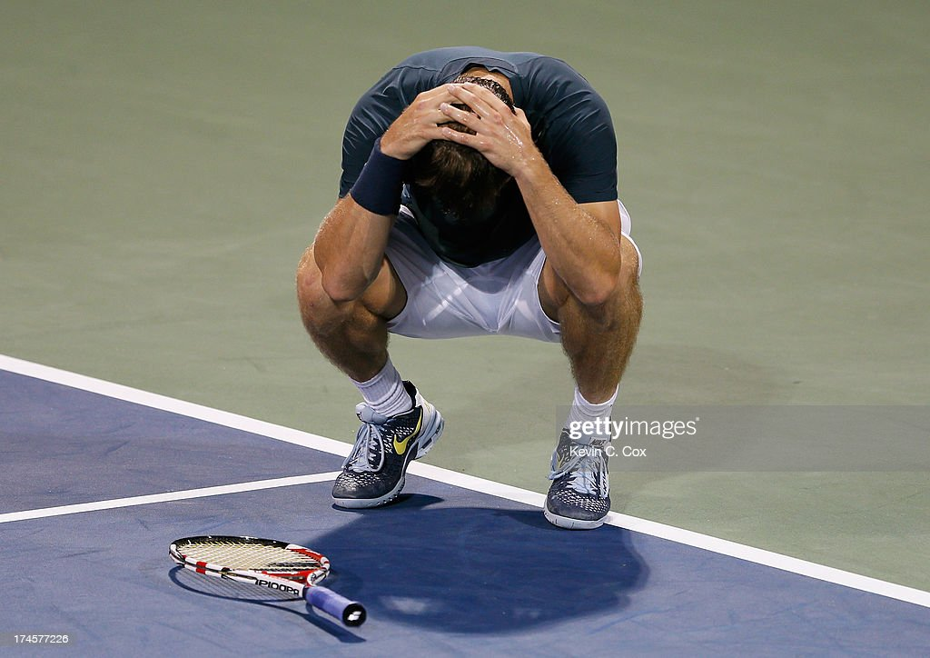 Ryan Harrison drops his racquet after a misplayed return to Kevin Anderson of South Africa during the BB&T Atlanta Open in Atlantic Station on July 27, 2013 in Atlanta, Georgia.