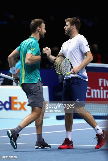 Ryan Harrison of The United States and Michael Venus of New Zealand celebrate during the doubles match against Nicolas Mahut of France and...