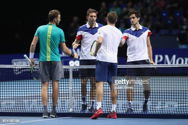 Ryan Harrison of The United States and Michael Venus of New Zealand shake hands with Nicolas Mahut of France and PierreHugues Herbert of France...