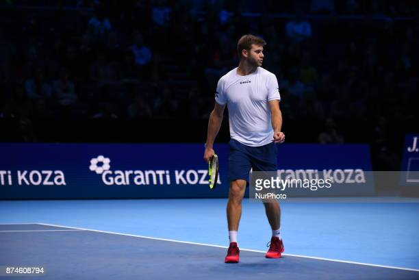 Ryan Harrison of The United States and Michael Venus of New Zealand in action during the doubles match against Nicolas Mahut of France and...