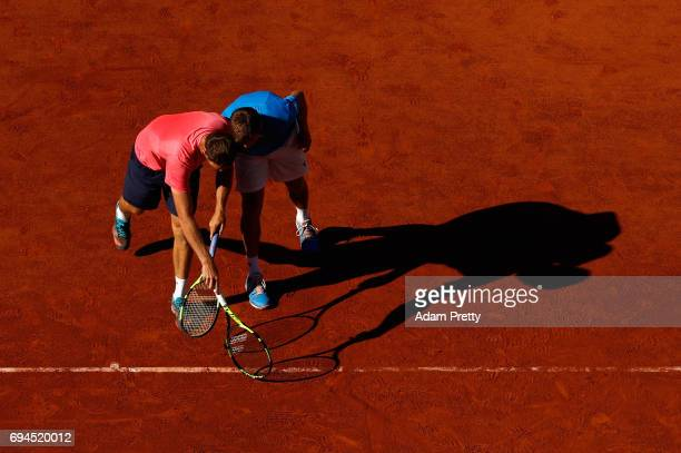 Ryan Harrison of The United States and partner Michael Venus of New Zealand take a detailed look at the court during the mens doubles final match...