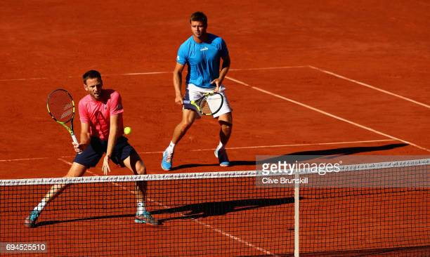 Ryan Harrison of The United States and partner Michael Venus of New Zealand return the ball during the mens doubles final match against Donald Young...