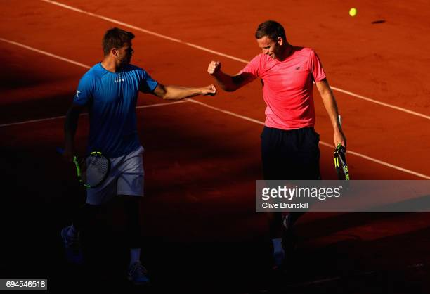 Ryan Harrison of The United States and partner Michael Venus of New Zealand look on during the mens doubles final match against Donald Young of The...