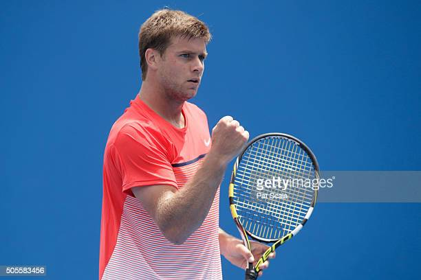 Ryan Harrison of the United States celebrates in his first round match against Andrey Kuznetsov of Russia during day two of the 2016 Australian Open...