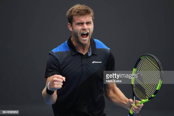 Ryan Harrison of the United States celebrates winning a point his first round match against Dudi Sela of Israel on day one of the 2018 Australian...