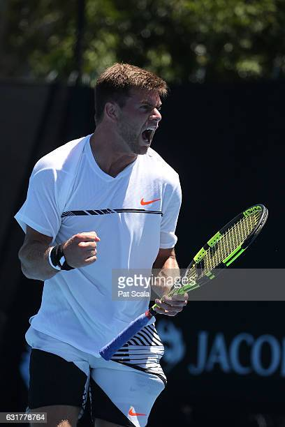 Ryan Harrison of the United States celebrates winning a point in his first round match against Nicolas Mahut of of France on day one of the 2017...