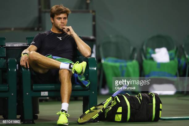 Ryan Harrison of the United States during the change over against Damir Dzumhur of Bosnia and Herzegovina in their first round match during day four...
