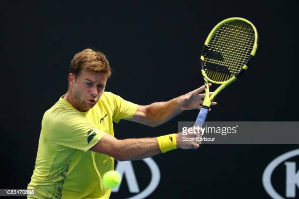 Ryan Harrison of the United States plays a backhand in his second round match against Daniil Medvedev of Russia during day four of the 2019...