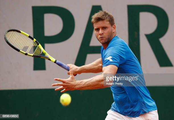 Ryan Harrison of The United States plays a forehand during the mens singles first round match against Aljaz Bedene of Great Britain on day two of the...