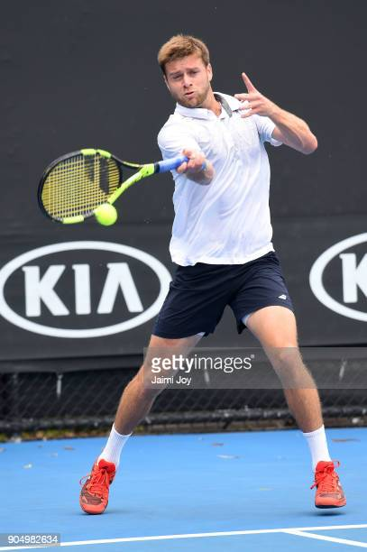 Ryan Harrison of the United States plays a forehand in his first round match against Dudi Sela of Israel on day one of the 2018 Australian Open at...