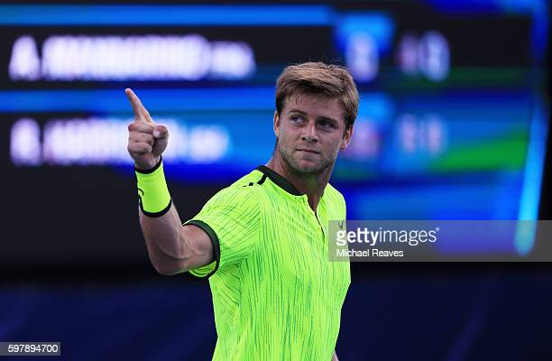 Ryan Harrison of the United States reacts against Adrian Mannarino of France during his first round Men's Singles match on Day One of the 2016 US...