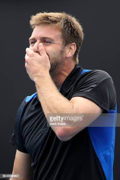 Ryan Harrison of the United States reacts in his first round match against Dudi Sela of Israel on day one of the 2018 Australian Open at Melbourne...