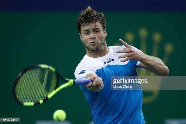 Ryan Harrison of the United States returns a shot during the Men's singles mach against Grigor Dimitrov of Bulgaria on day four of 2017 ATP Shanghai...