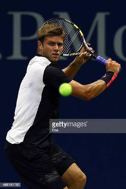 Ryan Harrison of the United States returns a shot to Rajeev Ram of the United States during their Men's Singles First Round match on Day Two of the...