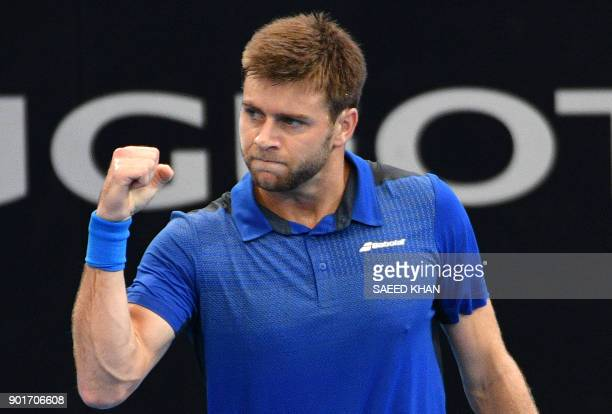 Ryan Harrison of the US celebrates his second set against Alex De Minaur of Australia during their men's singles semifinal match at the Brisbane...