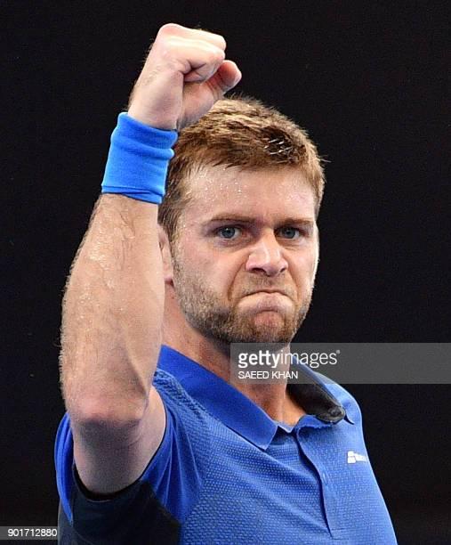 Ryan Harrison of the US celebrates his victory against Alex De Minaur of Australia in their men's singles semifinal match at the Brisbane...