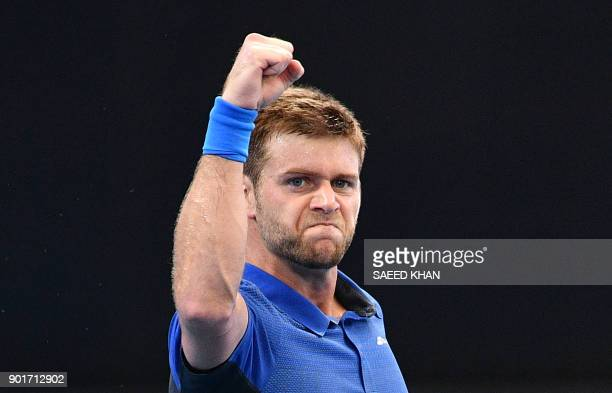 Ryan Harrison of the US celebrates his victory against Alex De Minaur of Australia in their men's singles semifinal match at the Brisbane...