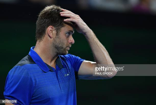 Ryan Harrison of the US gestures after a point against Croatia's Marin Cilic during their men's singles third round match on day five of the...