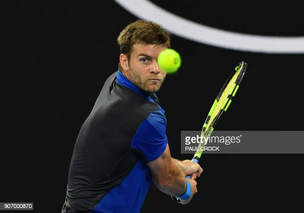 Ryan Harrison of the US plays a backhand return to Croatia's Marin Cilic during their men's singles third round match on day five of the Australian...