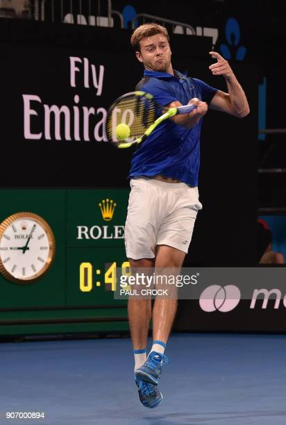Ryan Harrison of the US plays a forehand return to Croatia's Marin Cilic during their men's singles third round match on day five of the Australian...