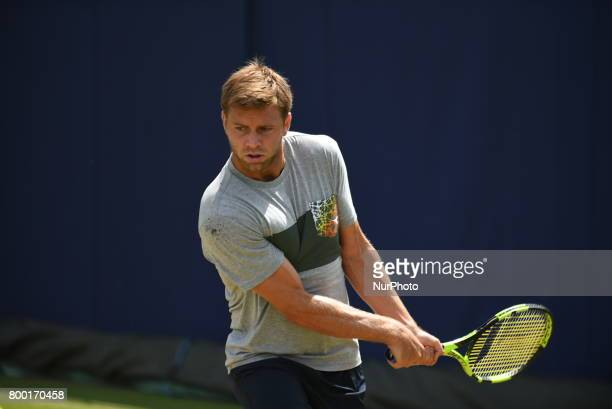 Ryan Harrison of the US practices at The Queen's Club London on June 22 2017 The players use the grass courts to train themselves before the start of...