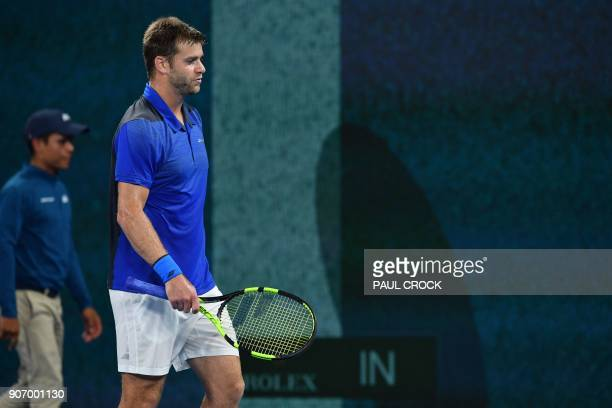 Ryan Harrison of the US reacts after a linecall for Croatia's Marin Cilic during their men's singles third round match on day five of the Australian...