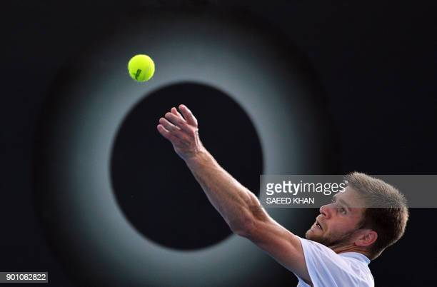 TOPSHOT Ryan Harrison of the US serves against Yannick Hanfmann of Germany during their men's singles second round match at the Brisbane...