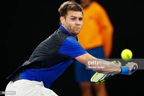 Ryan Harrison of the USA plays a backhand in his third round match against Marin Cilic of Croatia on day five of the 2018 Australian Open at...