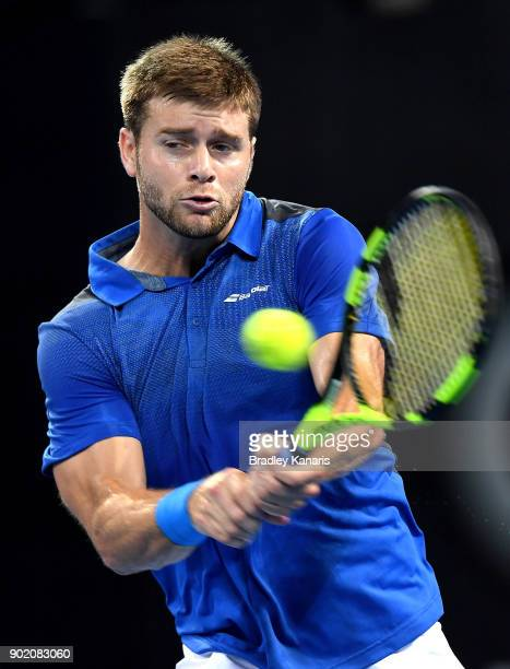 Ryan Harrison of the USA plays a backhand in the Men's Final match against Nick Kyrgios of Australia during day eight of the 2018 Brisbane...