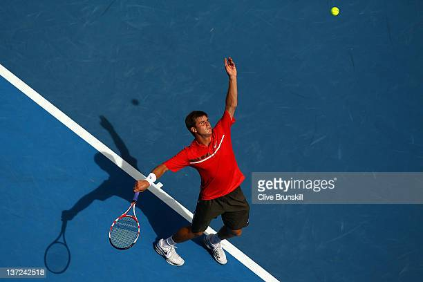 Ryan Harrison of the USA serves in his first round match against Andy Murray of Great Britain during day two of the 2012 Australian Open at Melbourne...