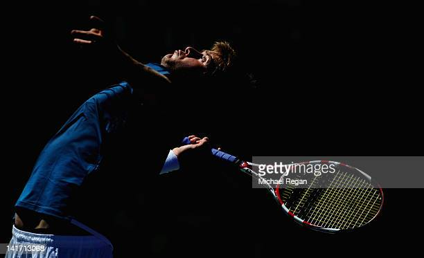 Ryan Harrison of the USA serves in his match against Potito Starace of Italy during day 4 of the Sony Ericsson Open at Crandon Park Tennis Center on...