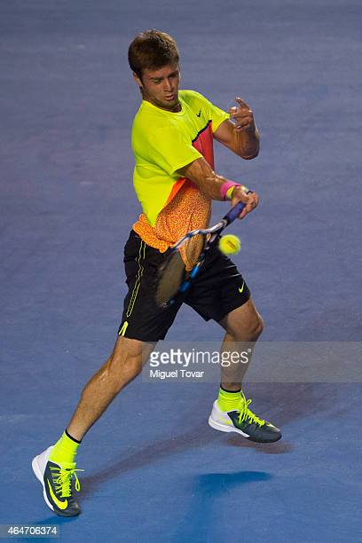 Ryan Harrison of US returns a shot during a men's singles match against David Ferrer of Spain as part of Telcel Mexican Open 2015 at Mextenis Stadium...