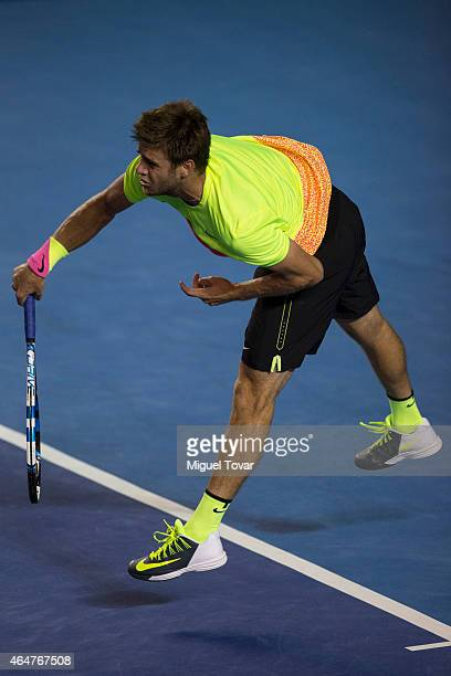 Ryan Harrison of US serves during a men's singles match against David Ferrer of Spain as part of Telcel Mexican Open 2015 at Mextenis Stadium on...