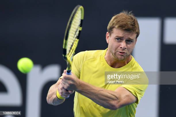 Ryan Harrison of USA plays a backhand in his match against Nick Kyrgios of Australia during day three of the 2019 Brisbane International at Pat...