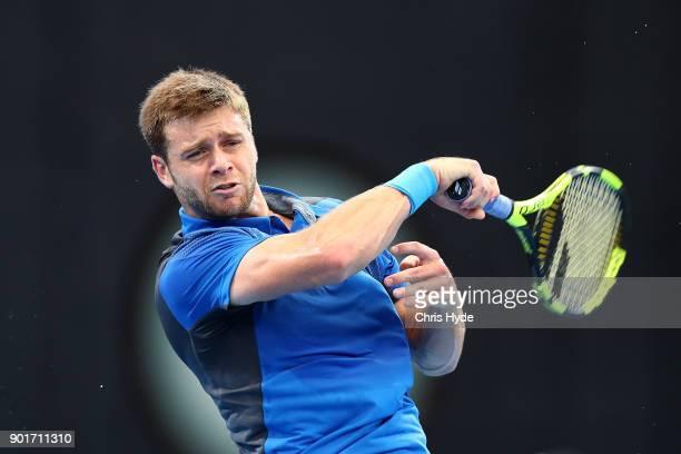 Ryan Harrison of USA plays a forehand in his semi final match against Alex de Minaur of Australia during day seven of the 2018 Brisbane International...