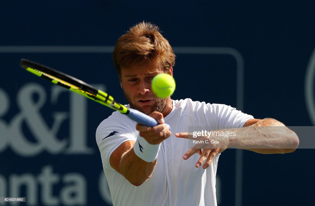 Ryan Harrison returns a forehand to John Isner during the BB&T Atlanta Open at Atlantic Station on July 30, 2017 in Atlanta, Georgia.