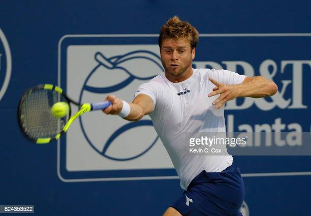 Ryan Harrison returns a forehand to Kyle Edmund of Great Britain during the BBT Atlanta Open at Atlantic Station on July 29 2017 in Atlanta Georgia