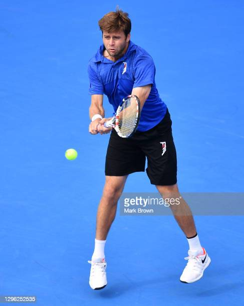 Ryan Harrison returns a shot against Ariel Behar of Uruguay and Gonzalo Escobar of Ecuador while playing with his brother Christian Harrison during...