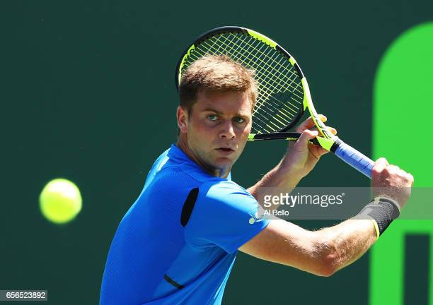 Ryan Harrison returns a shot against Fabio Fognini of Italy during day 3 of the Miami Open at Crandon Park Tennis Center on March 22 2017 in Key...