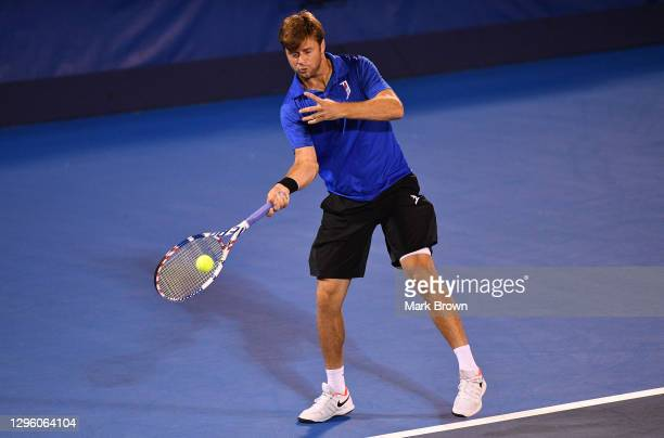 Ryan Harrison returns a shot against Hugo Nys of Monaco and Andrés Molteni of Argentina while playing with his brother Christian Harrison during the...