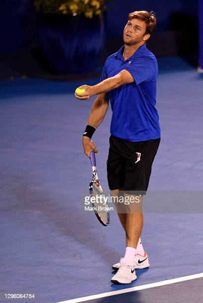 Ryan Harrison serves to Hugo Nys of Monaco and Andrés Molteni of Argentina while playing with his brother Christian Harrison during the Doubles...