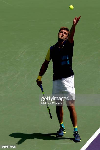 Ryan Harrison serves to Joao Sousa of Portugal during the Miami Open on March 21 2018 in Key Biscayne Florida