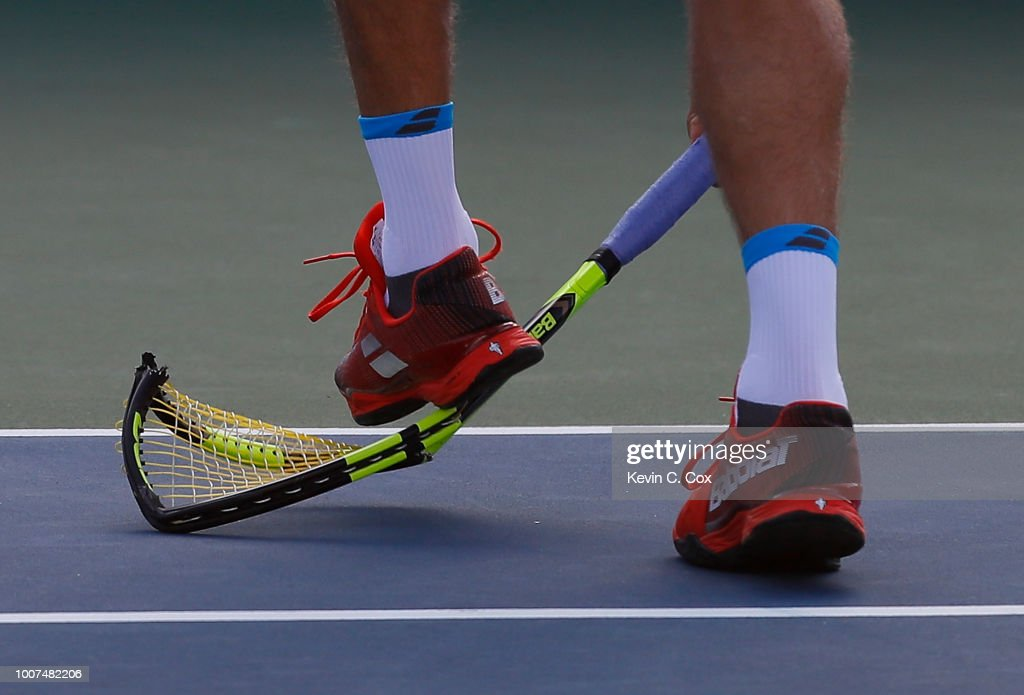 Ryan Harrison steps on his racquet after slamming it down on the court in the match against John Isner during the BB&T Atlanta Open at Atlantic Station on July 29, 2018 in Atlanta, Georgia.