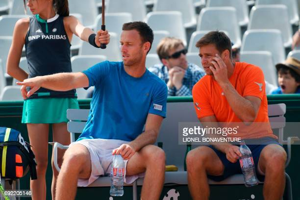 US Ryan Harrison talks to teammate NewZealand's Michael Venus as they play against India's Purav Raja and India's Divij Sharan during their men...